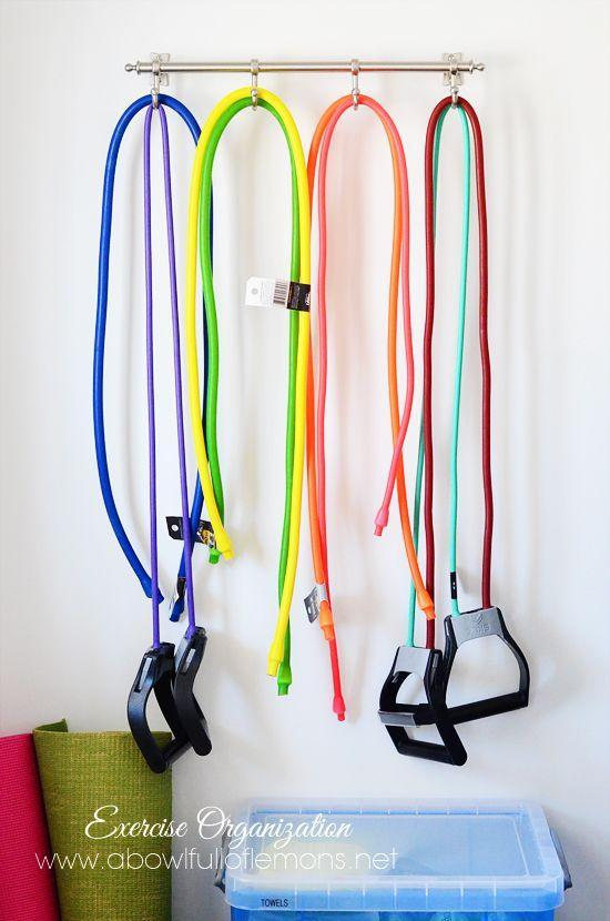 """<p>Resistance bands offer an easy way to squeeze in a workout, but there's no real great way to store them. That is, until we saw this on-the-wall method. Now there's no excuse to put off your workout.</p><p><a href=""""http://www.abowlfulloflemons.net/2013/04/exercise-room-organization.html"""" rel=""""nofollow noopener"""" target=""""_blank"""" data-ylk=""""slk:See more at A Bowl Full of Lemons »"""" class=""""link rapid-noclick-resp""""><em>See more at A Bowl Full of Lemons »</em></a></p>"""