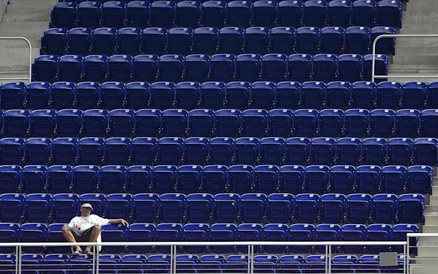 MIAMI, FL - MAY 18: A fan watches a game between the Miami Marlins and the Arizona Diamondbacks during a game at Marlins Park on May 18, 2013 in Miami, Florida. (Photo by Mike Ehrmann/Getty Images)