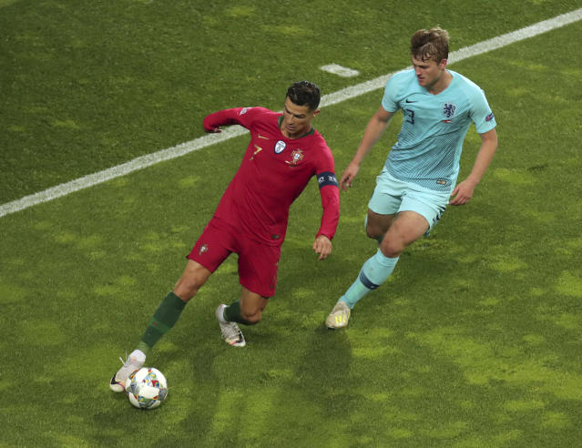 Portugal's Cristiano Ronaldo, left, duels for the ball with Netherlands' Matthijs de Ligt during the UEFA Nations League final soccer match between Portugal and Netherlands at the Dragao stadium in Porto, Portugal, Sunday, June 9, 2019. (AP Photo/Luis Vieira)