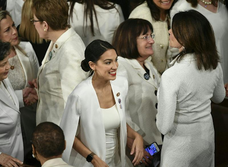 New York Representative Alexandria Octavio-Cortez (C) is seen amidst other Congress women at the State of the Union address
