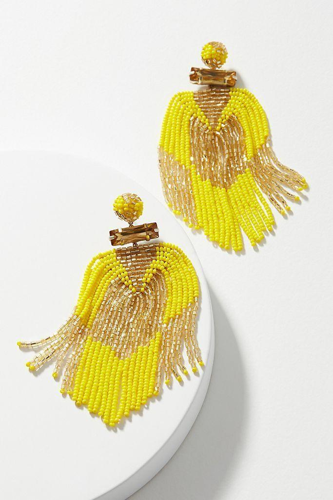 """<p><strong>Deepa</strong></p><p>anthropologie.com</p><p><strong>$58.00</strong></p><p><a href=""""https://go.redirectingat.com?id=74968X1596630&url=https%3A%2F%2Fwww.anthropologie.com%2Fshop%2Fdeepa-jodi-beaded-fringe-drop-earrings&sref=https%3A%2F%2Fwww.oprahmag.com%2Fstyle%2Fg32948480%2Fbest-earrings-for-sensitive-ears%2F"""" rel=""""nofollow noopener"""" target=""""_blank"""" data-ylk=""""slk:SHOP NOW"""" class=""""link rapid-noclick-resp"""">SHOP NOW</a></p><p>Not only are these festive beaded danglers in the 2021 Pantone Color of the Year Illuminating, they also have stainless steel backs. </p>"""
