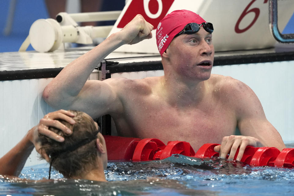 Tom Dean of Britain celebrates after winning the final of the men's 200-meter freestyle at the 2020 Summer Olympics, Tuesday, July 27, 2021, in Tokyo, Japan. (AP Photo/Matthias Schrader)