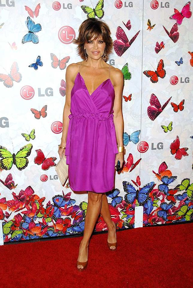 "Lisa Rinna, who recently bared all in Playboy at the age of 45, showed off her fab figure in a fuchsia frock. John Shearer/<a href=""http://www.wireimage.com"" target=""new"">WireImage.com</a> - April 28, 2009"