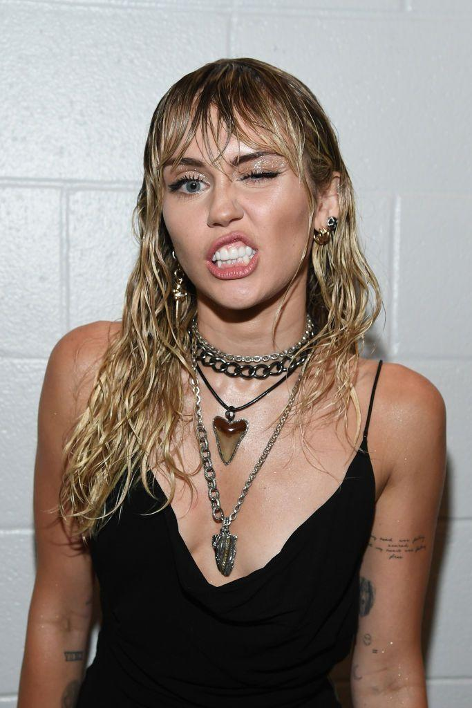 "<p>Miley has been hitting up her tattoo artist a lot lately. Less than a week after getting a tat inspired by her trip to Italy, the singer has some new ink on the inside of her upper left arm. It reads ""My head was feeling scared, but my heart was feeling free,"" a lyric from the Pixies' song, ""The Thing."" There's speculation that this is a comment on her recent split from Liam Hemsworth. It may represent the fact that following her divorce, she's scared, but she's feeling more free than ever before, but hey, that's just a guess. </p><p>Either way, this marks her second tattoo since her breakup. I'm thinking we can expect a drastic haircut coming very soon. </p>"