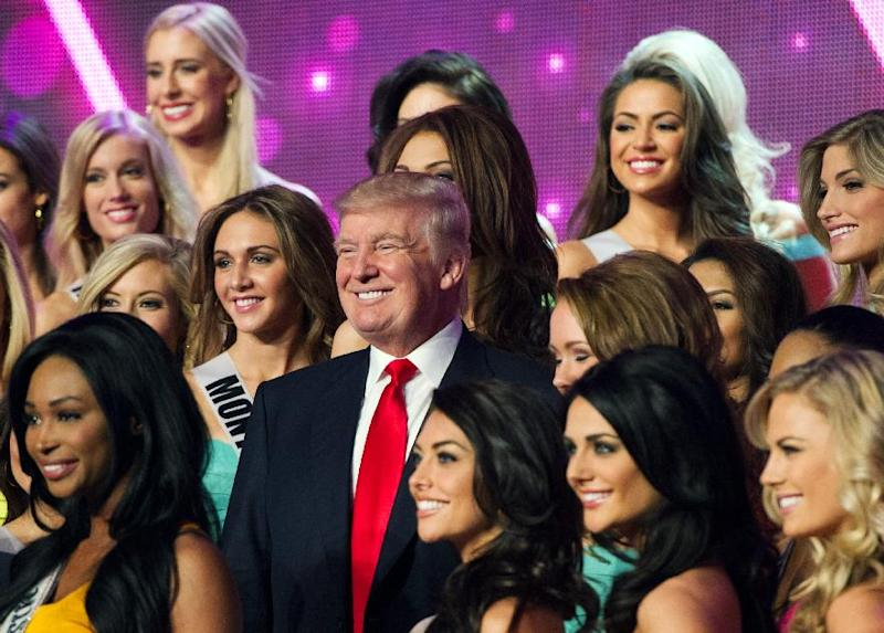 In this photo provided by the Miss Universe Organization, Donald Trump, co-owner of the Miss Universe Organization, poses for a photo with the competitors during rehearsal for the upcoming Miss USA Competition at PH Live in Las Vegas on Saturday, June 15, 2013. (AP Photo/Miss Universe Organization)