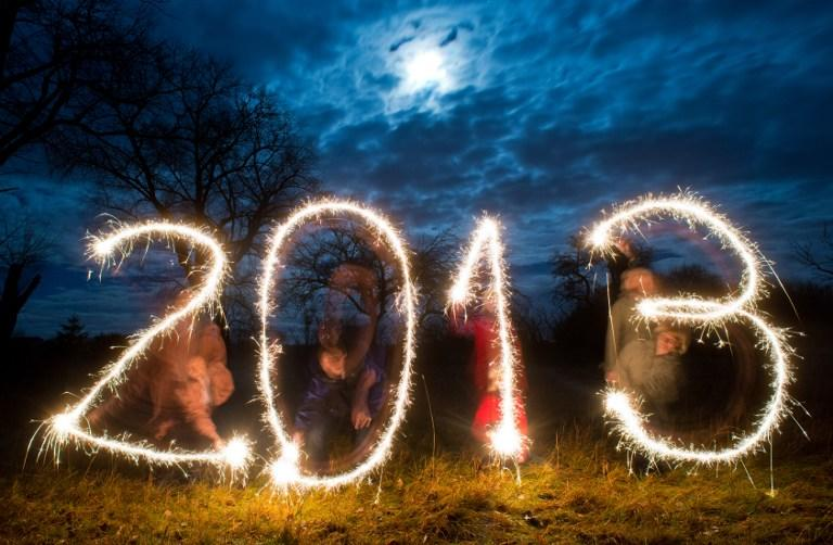 "Posed picture taken with long exposure time on December 26, 2012 shows four persons writing the date ""2013"" with sparklers in the evening sky near Sieversdorf, eastern Germany.       AFP PHOTO / PATRICK PLEUL    GERMANY OUT"