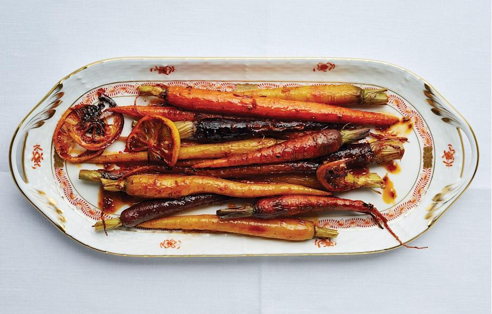 """A colorful and spicy (but not fiery!) side breaks up all the heavy, rich dishes on the table. <a href=""""https://www.bonappetit.com/recipe/harissa-and-maple-roasted-carrots?mbid=synd_yahoo_rss"""" rel=""""nofollow noopener"""" target=""""_blank"""" data-ylk=""""slk:See recipe."""" class=""""link rapid-noclick-resp"""">See recipe.</a>"""