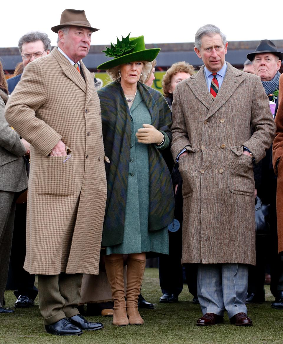 CHELTENHAM, UNITED KINGDOM - MARCH 17: (EMBARGOED FOR PUBLICATION IN UK NEWSPAPERS UNTIL 24 HOURS AFTER CREATE DATE AND TIME) Lord Samuel Vestey, Camilla, Duchess of Cornwall (wearing a St Patrick's Day themed hat adorned with shamrocks, designed by Philip Treacy) and Prince Charles, Prince of Wales attend day 4 'Gold Cup Day' of the Cheltenham Festival at Cheltenham Racecourse on March 17, 2006 in Cheltenham, England. (Photo by Max Mumby/Indigo/Getty Images)