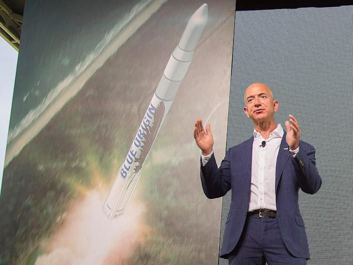 Amazon founder and Blue Origin founder Jeff Bezos (L) announces plans to build a rocket manufacturing plant and launch site at Cape Canaveral Air Force Station, Florida September 15, 2015.