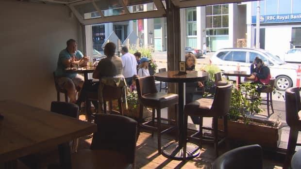 Patrons dine inside the Union Social Eatery on Saturday. The city of Toronto says it is still educating businesses about a new provincial policy on COVID-19 that requires customers to prove they are fully vaccinated. (CBC - image credit)