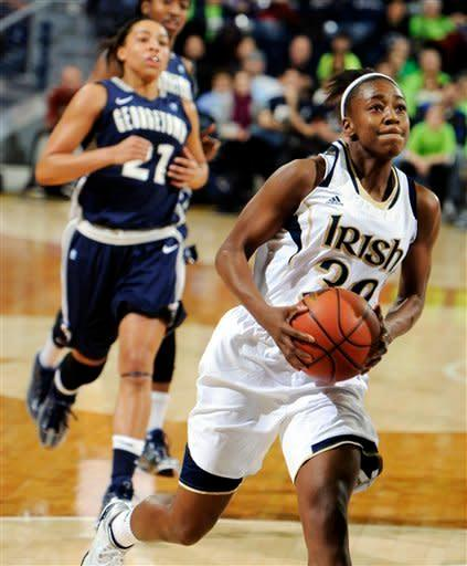 Notre Dame guard Jewell Loyd, right, drives the lane as Georgetown guard Jasmine Jackson gives chase during the first half of an NCAA college basketball game, Tuesday, Jan. 15, 2013, in South Bend, Ind. (AP Photo/Joe Raymond)