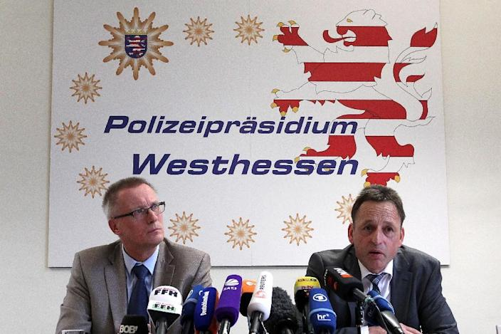 Albrecht Schreiber (L), Frankfurt's attorney general and the President of the police department in Wiesbaden Stefan Mueller address the media during a news conference in Wiesbaden, Germany (AFP Photo/Daniel Roland)