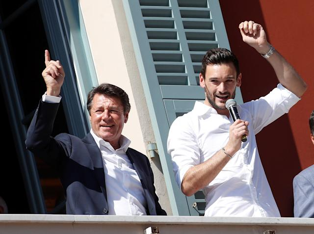 France soccer team goalkeeper Hugo Lloris and Christian Estrosi, Mayor of Nice, wave to the crowd from a balcony at the city hall in Nice, after their victory in the 2018 Russia Soccer World Cup, France, July 18, 2018. REUTERS/Eric Gaillard