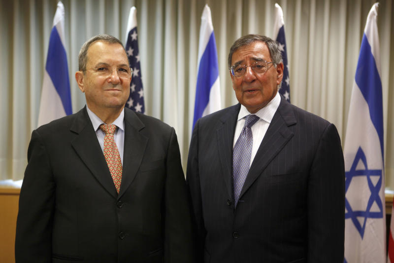 Israeli Defense minister Ehud Barak, left, and U.S. Defense Secretary Leon Panetta, right, meet in Tel Aviv, Israel, Wednesday, Aug. 1, 2012. Israel's threats to attack Iran and the violence convulsing Syria top the agenda of  Panetta's meetings Wednesday with Israeli government leaders. (AP Photo/Gali Tibbon, Pool)