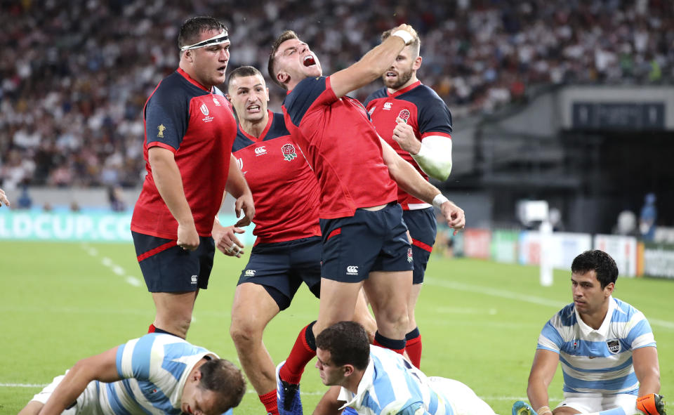 England's George Ford celebrates after scoring a try during the Rugby World Cup Pool C game at Tokyo Stadium between England and Argentina in Tokyo, Japan, Saturday, Oct. 5, 2019. (AP Photo/Eugene Hoshiko)