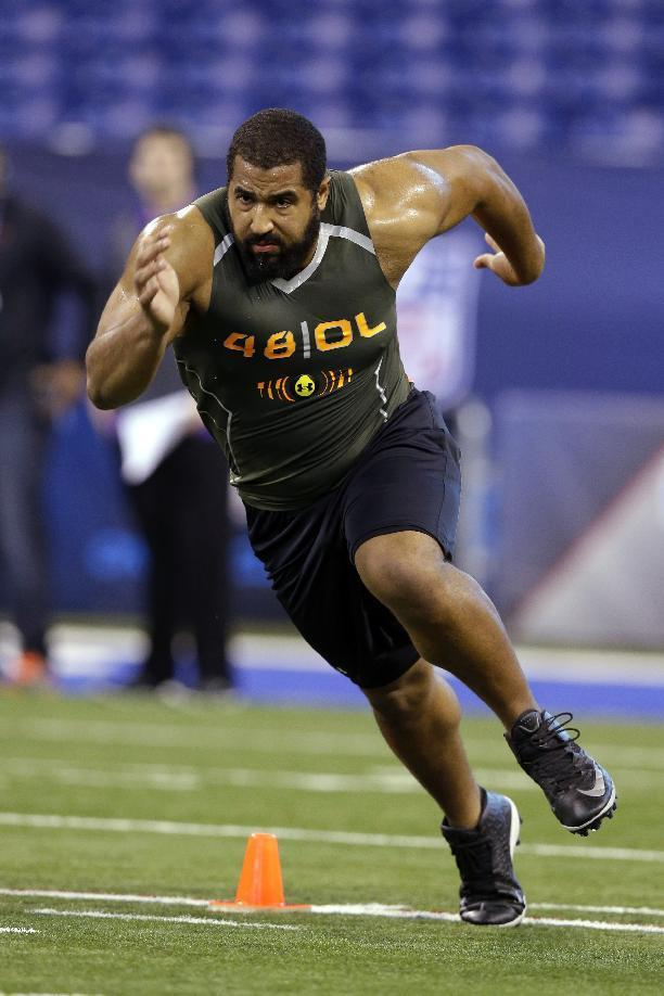 Penn State offensive lineman John Urschel runs a drill at the NFL football scouting combine in Indianapolis, Saturday, Feb. 22, 2014. The all-Big Ten, third-team AP All-American has a Master's degree in math and was awarded the William V. Campbell Trophy as college football's top scholar-athlete. (AP Photo/Michael Conroy)