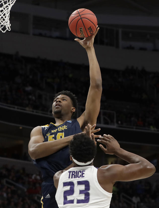 UC Irvine forward Elston Jones, top, shoots over Kansas State forward Austin Trice (23) during the second half of a first-round game in the NCAA mens college basketball tournament Friday, March 22, 2019, in San Jose, Calif. (AP Photo/Chris Carlson)