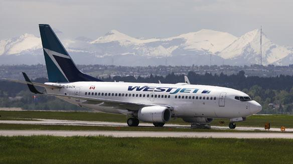 A WestJet flight taxis for takeoff from Calgary, but it won't be taking contest winners on a tropical vacation. The airline says phone calls to people promising such a prize are a scam.