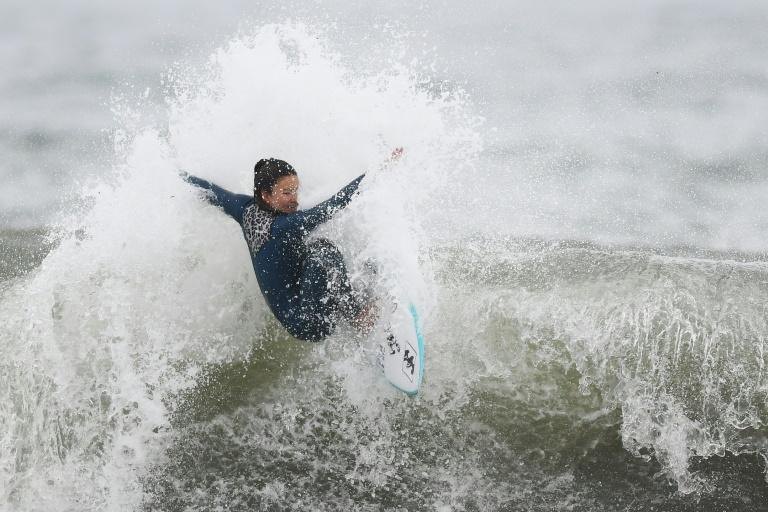 Surf's up: Shino Matsuda trains at Kamogawa as the 16-year-old aims for home Olympic gold next year