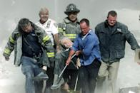 "Rescue workers carry mortally injured New York City Fire Department chaplain Mychal Judge from the wreckage after he was killed by falling debris while administering last rites to another victim. A Roman Catholic priest, a recovering alcoholic, a gay man, and -- as an FDNY chaplain a spiritual adviser and trusted friend to countless firefighters through the years -- ""Father Mike"" was the first recorded victim of the September 11 attacks. Photographer Shannon Stapleton's picture, which burns with immediacy and yet somehow feels composed, almost painterly, captures much of the day's intense incongruities in one sombre frame: the intimacy of witnessing a single death in the midst of a monumental catastrophe; brilliant sunlight shining on the chaplain's lifeless hands; devastated first responders shrugging off exhaustion, racing to the aid of helpless victims. Here is the best, and the very worst, of that day. <br><br>(Photo: SHANNON STAPLETON/Reuters /Landov ) <br><br>For the full photo collection, go to <a href=""http://www.life.com/gallery/59971/911-the-25-most-powerful-photos#index/0"" rel=""nofollow noopener"" target=""_blank"" data-ylk=""slk:LIFE.com"" class=""link rapid-noclick-resp"">LIFE.com</a>"