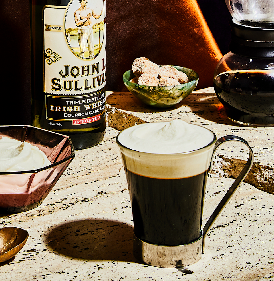 """<p>Nirvana can be found at the bottom of your first Irish Coffee. Perhaps your second. Hot, strong, and almost sweet, it's damn near revelatory on an otherwise shit day. </p><p><a class=""""link rapid-noclick-resp"""" href=""""https://www.esquire.com/food-drink/drinks/recipes/a3808/irish-coffee-drink-recipe/"""" rel=""""nofollow noopener"""" target=""""_blank"""" data-ylk=""""slk:Read More"""">Read More</a></p><p><strong>Ingredients</strong><br>• 2 oz. Irish whiskey<br>• 5 oz. coffee<br>• 2 tsp. sugar<br>• heavy cream </p><p><strong>Directions</strong><br>Pour the whiskey, coffee, and sugar into a heated glass mug. Stir, then top off with a thick layer of lightly whipped heavy cream. Don't stir it in.<br></p>"""