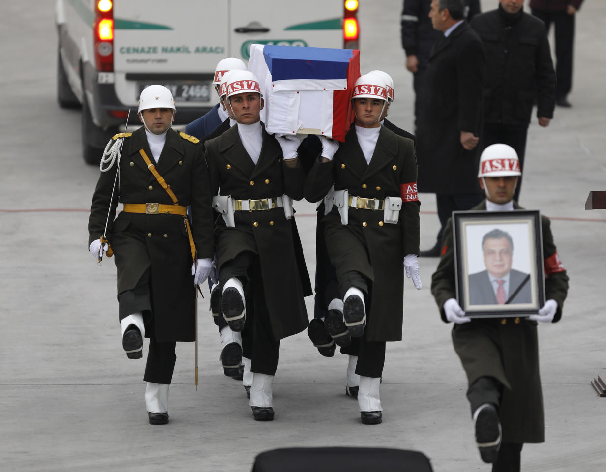 <p>Flag-wrapped coffin of late Russian Ambassador to Turkey Andrey Karlov is carried to a plane during a ceremony at Esenboga airport in Ankara, Turkey on Dec. 20, 2016. (Umit Bektas/Reuters) </p>