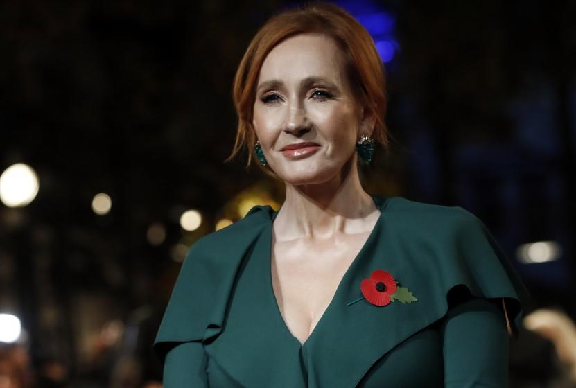 """FILE - In this Thursday, Nov. 8, 2018 file photo, writer J.K. Rowling poses for the media at the world premiere of the film """"Fantastic Beasts: The Crimes of Grindelwald"""" in Paris. Dozens of artists, writers and academics have signed an open letter decrying the weakening of public debate, it was announced Wednesday, July 8, 2020 warning that the free exchange of information and ideas is in jeopardy. J.K. Rowling, Salman Rushdie and Margaret Atwood are among dozens of writers, artists and academics to argue against ideological conformity in an open letter in Harper's Magazine. The letter comes amid a debate over so-called cancel culture - where prominent people face attack for sharing controversial opinions. (AP Photo/Christophe Ena, file)"""
