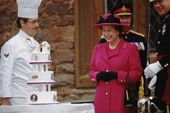 <p>The Queen was presented with a tiered birthday cake, which happened to coordinate with her pink suit, while visiting Powis Castle in Wales. </p>