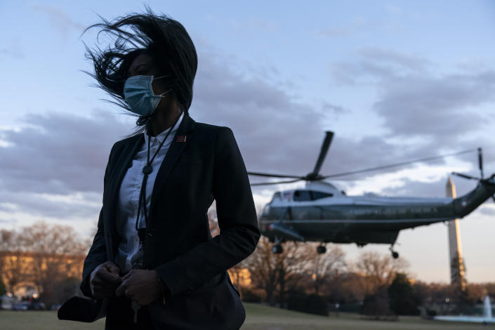 The rotor wash from Marine One, with President Joe Biden aboard, blows the hair of U.S. Secret Service Special Agent upon lift off from the South Lawn of the White House, Friday, Feb. 5, 2021, in Washington. (AP Photo/Alex Brandon)