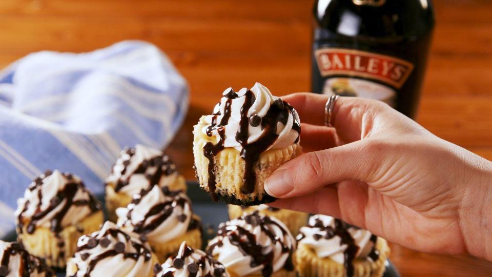 """<p>Boozy AND covered in chocolate sauce? YES, PLEASE. </p><p>Get the recipe from <a href=""""https://www.delish.com/cooking/recipe-ideas/a26410492/mini-baileys-cheesecakes-recipe/"""" rel=""""nofollow noopener"""" target=""""_blank"""" data-ylk=""""slk:Delish"""" class=""""link rapid-noclick-resp"""">Delish</a>.</p>"""