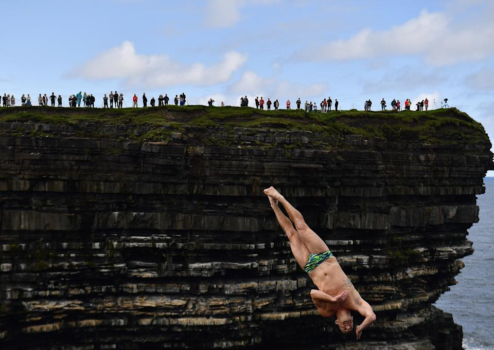 Steven LoBue of USA dives during the 2021 Cliff Diving World Series in Downpatrick Head, Ireland, September 12, 2021. REUTERS/Clodagh Kilcoyne     TPX IMAGES OF THE DAY