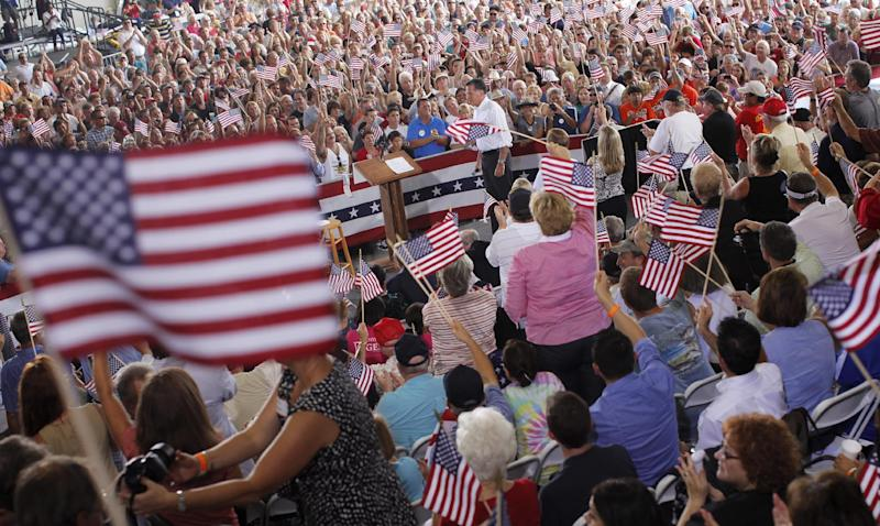 Republican presidential candidate Mitt Romney, center, campaigns at the Military Aviation Museum in Virginia Beach, Va., Saturday, Sept. 8, 2012. (AP Photo/Charles Dharapak)