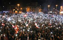 Demonstrators take part in an anti-government protest in Tripoli