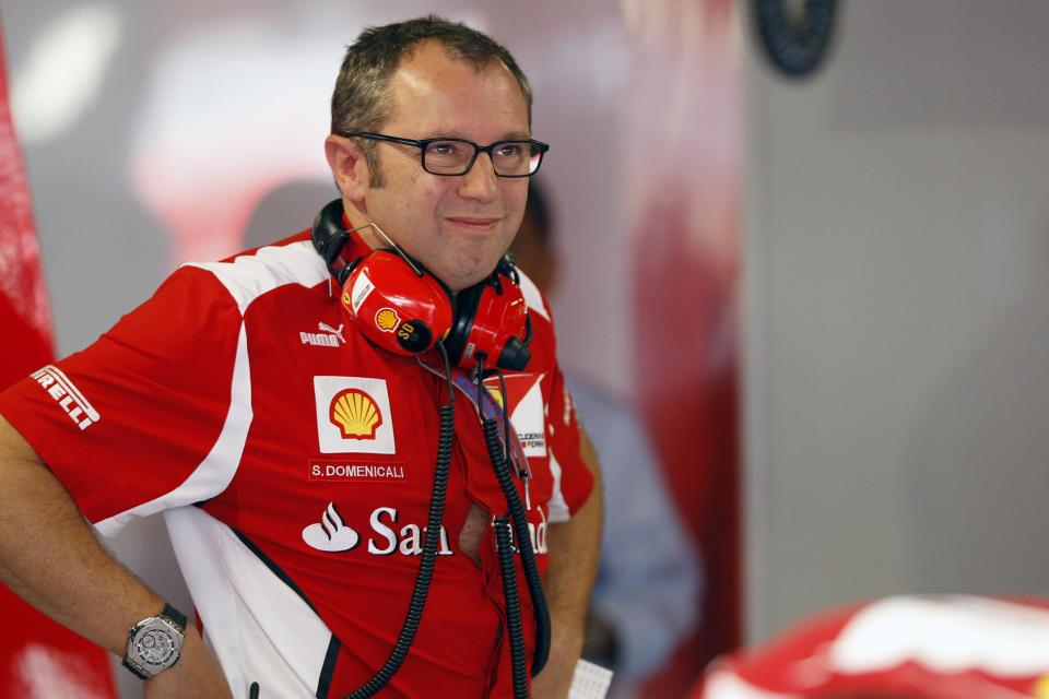 Ferrari Formula One team principal Stefano Domenicali reacts during the third practice session of the Italian F1 Grand Prix at the Monza circuit September 8, 2012. REUTERS/Giampiero Sposito (ITALY - Tags: SPORT MOTORSPORT F1)
