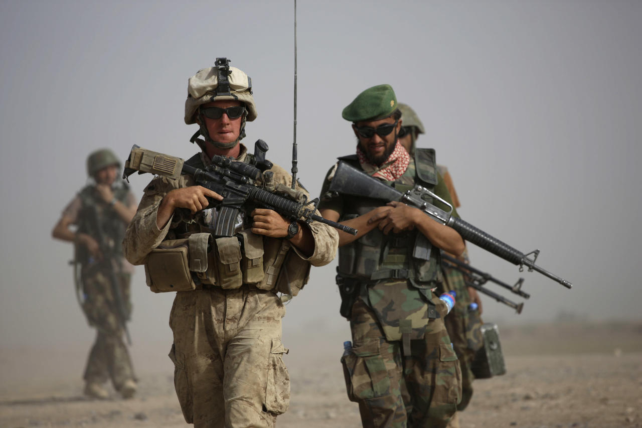 FILE - In this Oct. 3, 2009 file photo, U.S. Marine squad leader Sgt. Matthew Duquette, left, of Warrenville, Ill., with Bravo Company, 1st Battalion 5th Marines walks with Afghan National Army Lt. Hussein, during in a joint patrol in Nawa district, Helmand province, southern Afghanistan. U.S. military officials have noted that Afghan security forces are dying in insider attacks along with foreign troops, but so far, the Afghan government has not provided statistics on the number killed. (AP Photo/Brennan Linsley, File)