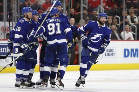Mar 14, 2019; Detroit, MI, USA; Tampa Bay Lightning right wing Nikita Kucherov (86) celebrates with teammates after scoring a goal during the third period against the Detroit Red Wings at Little Caesars Arena. Mandatory Credit: Raj Mehta-USA TODAY Sports