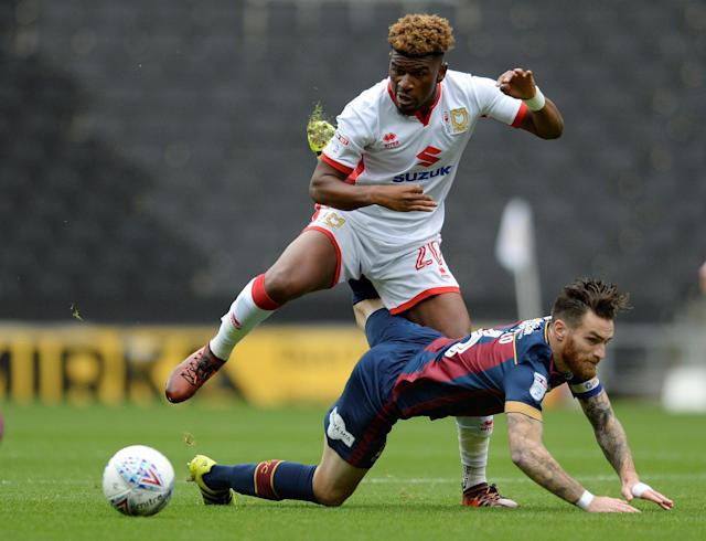 "Soccer Football - League One - Milton Keynes Dons vs Bradford City - Stadium MK, Milton Keynes, Britain - October 7, 2017 Bradford's Romain Vincelot in action with MK Dons' Aaron Tshibola Action Images/Alan Walter EDITORIAL USE ONLY. No use with unauthorized audio, video, data, fixture lists, club/league logos or ""live"" services. Online in-match use limited to 75 images, no video emulation. No use in betting, games or single club/league/player publications. Please contact your account representative for further details."