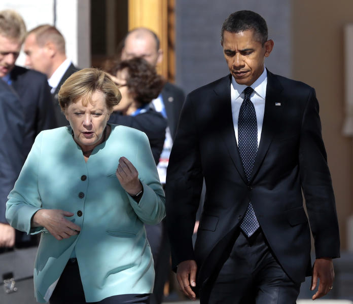 FILE - In this Sept. 6, 2013, file photo, President Barack Obama, right, walks with Germany's Chancellor Angela Merkel prior to a group photo of G-20 leaders outside of the Konstantin Palace in St. Petersburg, Russia. Reports based on leaks from former NSA systems analyst Edward Snowden suggest the U.S. has monitored the telephone communications of 35 foreign leaders. The fact that Merkel was among them has been particularly troubling to many in Europe and on Capitol Hill, given her status as a senior stateswoman, the leader of Europe's strongest economy, and a key American ally on global economics, Iranian nuclear negotiations and the Afghanistan war. (AP Photo/Ivan Sekretarev, File)