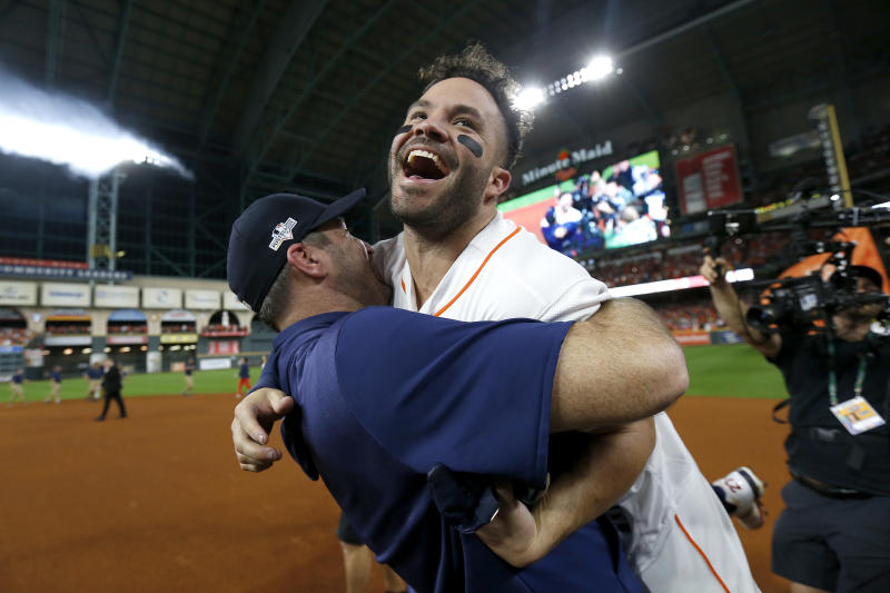 Jose Altuve of the Houston Astros is congratulated by his teammate Justin Verlander.