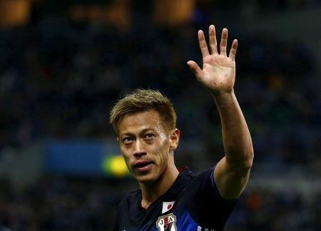 FILE PHOTO: Football Soccer - Japan v Syria - World Cup 2018 Qualifier - Saitama Stadium, Saitama, Japan - 29/3/16 Japan's Keisuke Honda celebrates after scoring the third goal for Japan against Syria. REUTERS/Thomas Peter Picture Supplied by Action Images/File Photo