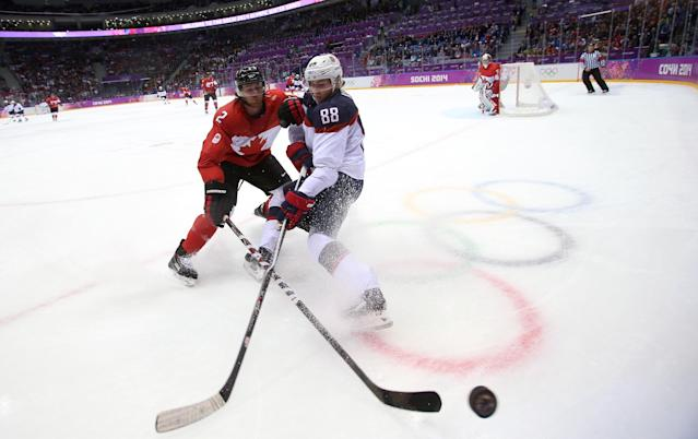 SOCHI, RUSSIA - FEBRUARY 21: Patrick Kane #88 of the United States challenges Duncan Keith #2 of Canada for the puck during the Men's Ice Hockey Semifinal Playoff on Day 14 of the 2014 Sochi Winter Olympics at Bolshoy Ice Dome on February 21, 2014 in Sochi, Russia. (Photo by Bruce Bennett/Getty Images)
