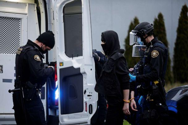 PHOTO: Police detain a person during a protest in Portland, Oregon, on Jan. 20, 2021, after the inauguration of President Joe Biden. (Lindsey Wasson/Reuters)