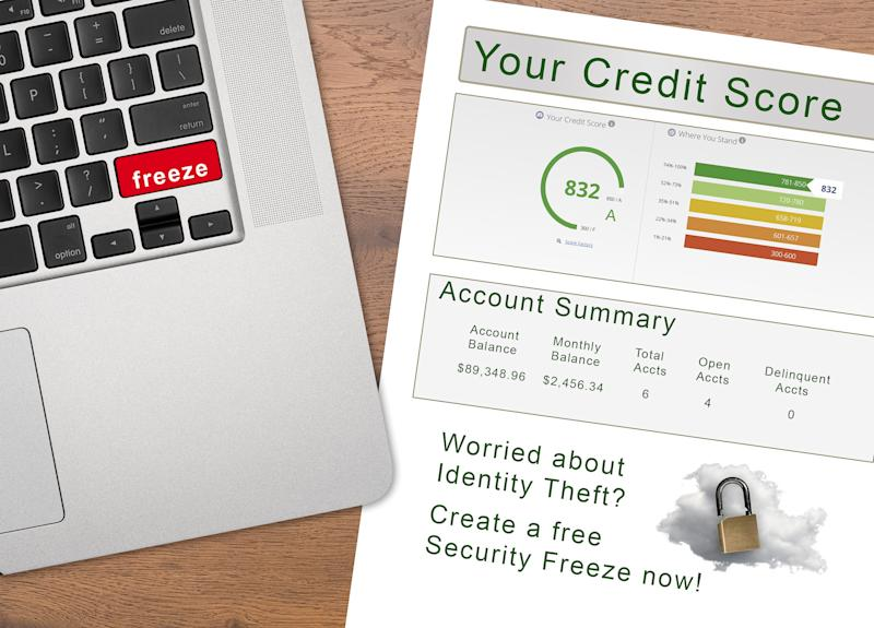 Laptop with Freeze on the red key by credit score report as concept for new law allowing free credit freezes with agencies