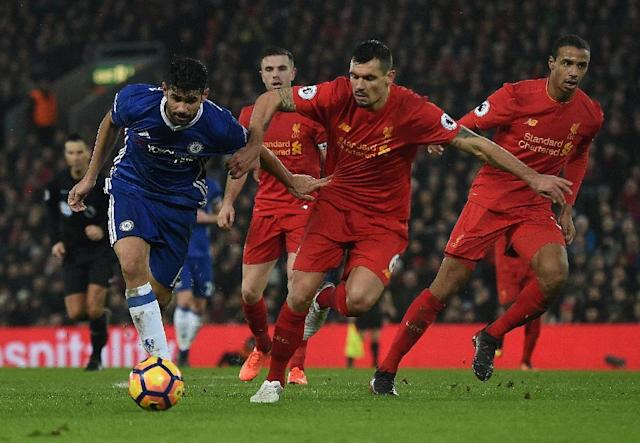 Chelsea's Diego Costa (L) fights for the ball with Liverpool's Dejan Lovren during their English Premier League match, at Anfield in Liverpool, on January 31, 2017 (AFP Photo/Paul ELLIS)