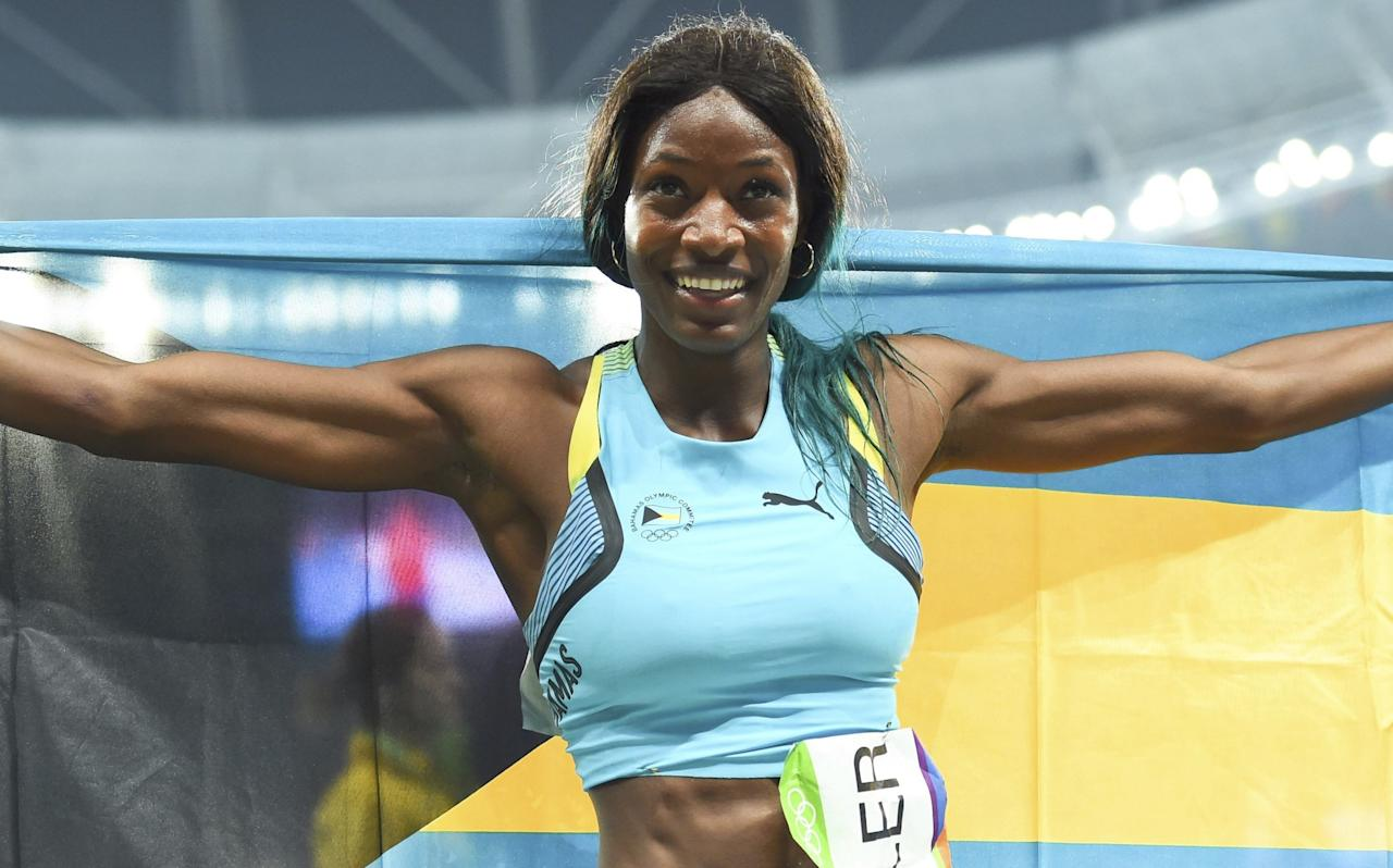<p>First placed Shaunae Miller (BAH) of Bahamas celebrates. (Reuters) </p>