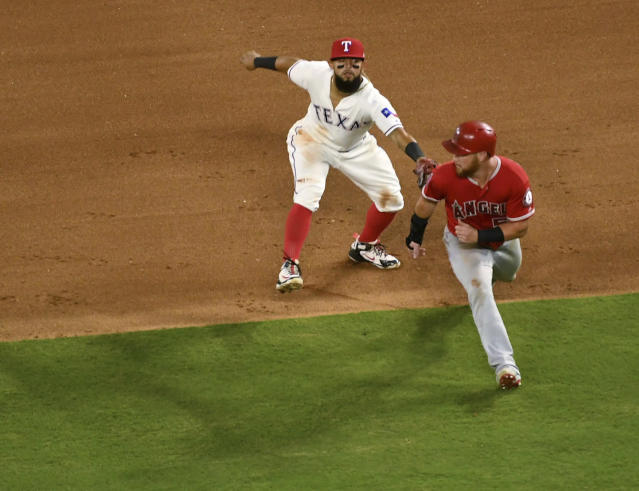 Texas Rangers second baseman Rougned Odor tags out Los Angeles Angels' David Fletcher for the third out of a triple play on a ground ball by Fletcher off Texas Rangers starting pitcher Ariel Jurado during the fourth inning of a baseball game Thursday, Aug. 16, 2018, in Arlington, Texas. Taylor Ward and Eric Young Jr. were also out on the play. (AP Photo/Jeffrey McWhorter)