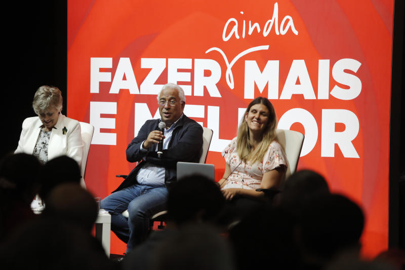 """Portuguese Prime Minister and Socialist Party leader Antonio Costa answers questions during a meeting with citizens to discuss inclusion policies for disabled people, Sunday, Sept. 21, 2019. At left is member of parliament Maria da Luz Rosinha and at right Ana Sofia Antunes, Secretary of State for the Inclusion of People with Disabilities. Poster in the background reads """"Do even more and better"""". Portugal's governing Socialist Party is hoping an economic recovery over the past four years will ensure it is returned to power in an Oct. 6 general election. (AP Photo/Armando Franca)"""