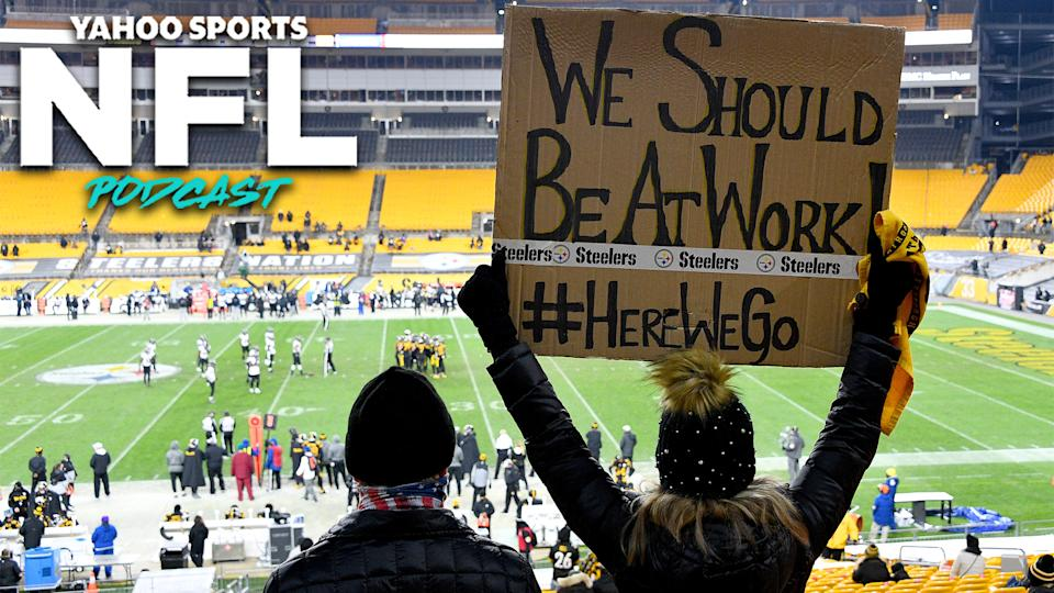 A fan holds up a sign during an extremely rare Wednesday NFL game between the Pittsburgh Steelers & Baltimore Ravens. (Photo by Joe Sargent/Getty Images)