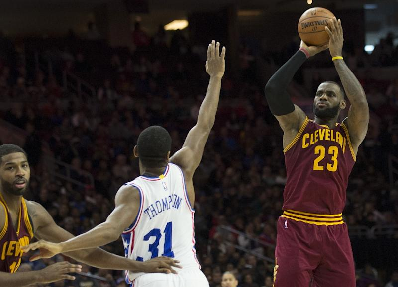 LeBron James of the Cleveland Cavaliers shoots over Hollis Thompson of the Philadelphia 76ers in the fourth quarter at Wells Fargo Center on November 27, 2016