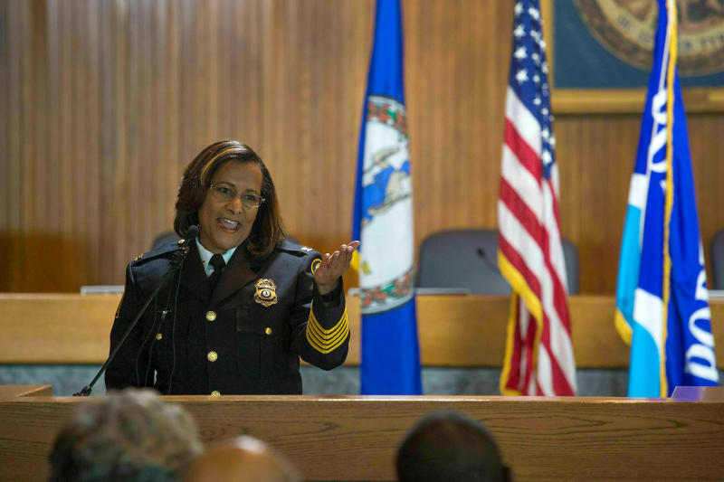 """In this Monday, Feb. 22, 2016 photo, Portsmouth Police Chief Tonya Chapman makes remarks after an oath of office ceremony at the City Council Chambers in Portsmouth, Va. Chapman, the first black woman to lead a city police department in Virginia, says she was forced out, accusing a small group of officers of """"bias and acts of systemic racism, discriminatory practices and abuse of authority."""" Chapman released a four-page statement early Monday, March 25, 2019,  a week after she abruptly resigned from the Portsmouth Police Department.  (Hyunsoo Leo Kim/The Virginian-Pilot via AP)"""
